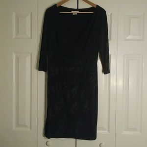 Classic black cocktail dress with lace detail.
